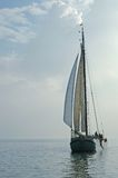 Classic Dutch sailing ship. Under the clouds Stock Photo