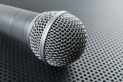 Classic dynamic microphone. On black background  perforated Royalty Free Stock Photo