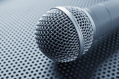Classic dynamic microphone. On black background  perforated Royalty Free Stock Image