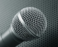 Classic dynamic microphone. On black background perforated. Toned Royalty Free Stock Photo