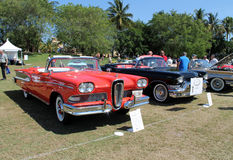 Classic Edsel in row of cars. Classic red 1958 Edsel Pacer convertible in a row next to cadillac convertible at 2014 Boca Raton concours d'elegance with people Royalty Free Stock Image