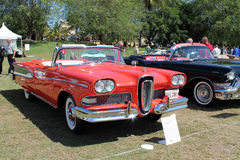 Classic Edsel in row of cars. Classic red 1958 Edsel Pacer convertible in a row next to cadillac convertible at 2014 Boca Raton concours d'elegance with people Royalty Free Stock Photography