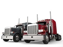 Classic eighteen wheeler trucks in metallic gray and red colors Stock Photography