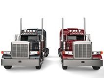 Classic eighteen wheeler trucks in metallic gray and red colors - front view Royalty Free Stock Images