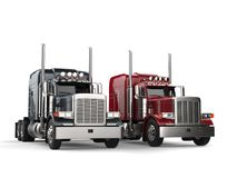 Classic eighteen wheeler trucks in metallic gray and red colors - side by side Stock Photo