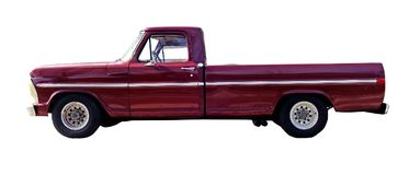 Classic Eighties Red PickupTruck. Side view of classic eighties red long bed pickup truck. Isolated royalty free stock photography