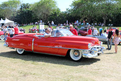 Classic Eldorado driving on field Royalty Free Stock Images