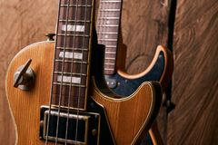 Classic electric guitar and wooden electric bass guitar Royalty Free Stock Image
