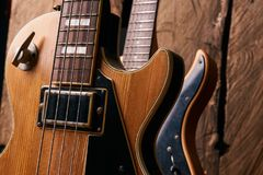 Classic electric guitar and wooden electric bass guitar Stock Image
