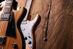 Classic electric guitar and wooden electric bass guitar Stock Photos