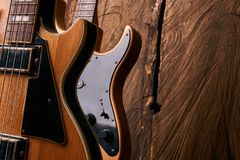 Classic electric guitar and wooden electric bass guitar Stock Photography