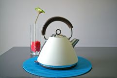 Retro Kettle with Flower Stock Images