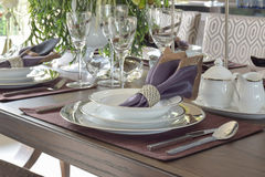 Classic elegance style dining set on wooden dining table Stock Images