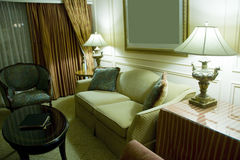 Classic elegant, sofa, armchair and table. In tasteful sitting room Royalty Free Stock Images