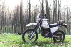 Classic enduro motorcycle off road in spring forest, concept, active lifestyle royalty free stock image