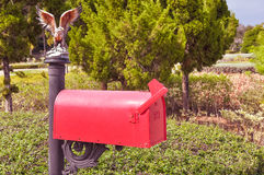Classic English red mailbox on the pillar Stock Photography