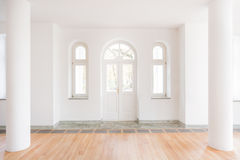 Classic entrance hall. Design of classic entrance hall with big white door Royalty Free Stock Image