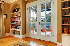 Classic entrance hall with wooden glass doors and built-in wall Royalty Free Stock Photos