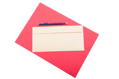 Classic envelop and pen on red background in top view Stock Photography
