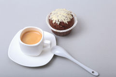 Classic espresso in white cup with homemade cake and chocolate on white background. Royalty Free Stock Images