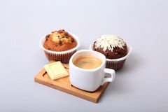 Classic espresso in white cup with homemade cake and chocolate on white background. Stock Photos