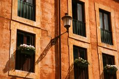 Classic facade. With windows, flowers and a lamp Royalty Free Stock Photography