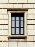 Classic facade with one square window. Detail of the facade of a classic building with a square window, portrait cut Stock Photography