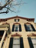 Classic Facade and shutters on the sunny streets of Savannah, Georgia - USA. Savannah, a coastal Georgia city, is separated from South Carolina by the Savannah Stock Photos