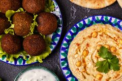 Classic falafel and hummus on the plates. Top view Stock Image