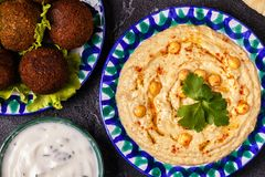 Classic falafel and hummus on the plates. Top view Stock Photography