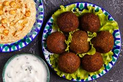 Classic falafel and hummus on the plates. Top view Royalty Free Stock Photos