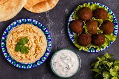 Classic falafel and hummus on the plates. Top view Royalty Free Stock Images