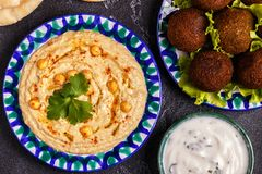 Classic falafel and hummus on the plates. Top view Royalty Free Stock Photo