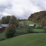Classic Farm in Fall. New England farm scene with fall colors starting Stock Image