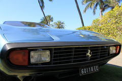 Classic ferrari face concealed headlamps. Ferrari 365 gtc grill and headlamps close up Stock Photos