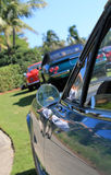 Classic ferrari wing mirror and cars in background Royalty Free Stock Photo