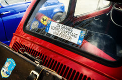 Classic Fiat 500 with funny license plate. ALBA, ITALY - MARCH 19, 2017 - Red Fiat 500 Abarth with funny plate `I want to became a Ferrari`, during a classic car Royalty Free Stock Image