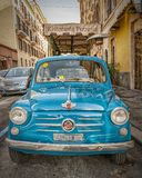 Classic Fiat 600 in Rome. ROME, ITALY - JANUARY 07, 2014: A classic blue Fiat 600 parked in a street in Rome, Italy royalty free stock photo