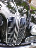 Classic fifties BMW car. Classic fifties  BMW car chrome grill, hood and head lights of a  black vintage   car and reflection Royalty Free Stock Images