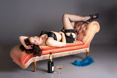 Classic fifties pinup celebrates with champagne Royalty Free Stock Photography