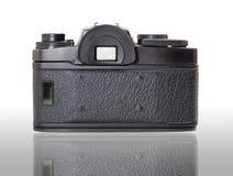 Classic film camera isolation on white. Classic film camera, rear view, isolation with reflection Stock Photo