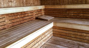 Classic Finnish sauna wood interior relaxing health and wellbeing. Pampered in a classic wood Finnish sauna room royalty free stock image