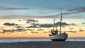 Classic fishing boat. Fishing boat in for the night at the beach in Slettestrand Denmark Stock Photos