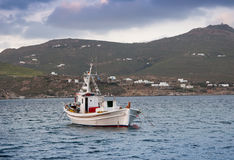 Classic fishing boat in the sea. Greece. Mykonos. Royalty Free Stock Images
