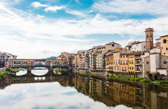 Classic Florence city view. City view of Ponte Vecchio bridge and the Arno River in Florence, Italy Royalty Free Stock Images