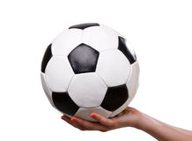 Classic football ball in hand Royalty Free Stock Images