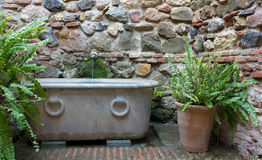 Classic Fountain Beside a Medieval Wall Royalty Free Stock Photography