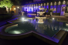Classic fountain. At night. Violet background Royalty Free Stock Photo