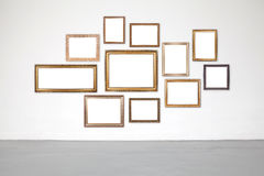Classic frame on white cement wall in gallery. Classic frame on white cement wall in showroom and gallery Royalty Free Stock Photo