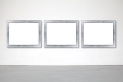 Classic frame on white cement wall in gallery. Stock Image